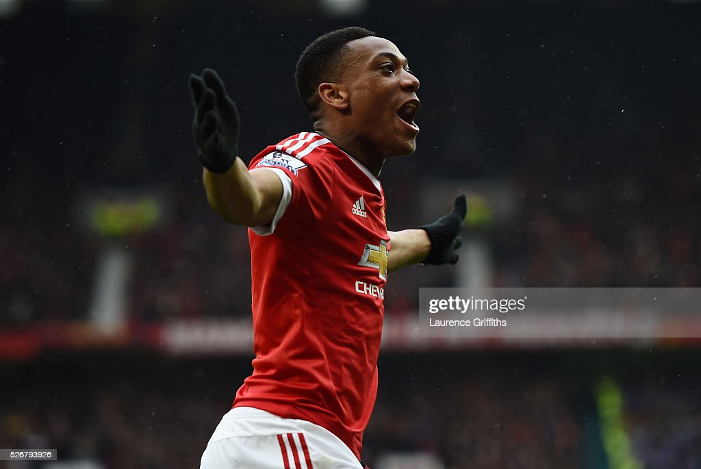 <a gi-track='captionPersonalityLinkClicked' href=/galleries/search?phrase=Anthony+Martial&family=editorial&specificpeople=9197434 ng-click='$event.stopPropagation()'>Anthony Martial</a> of Manchester United celebrates scoring the opening goal during the Barclays Premier League match between Manchester United and Leicester City at Old Trafford on May 1, 2016 in Manchester, England.
