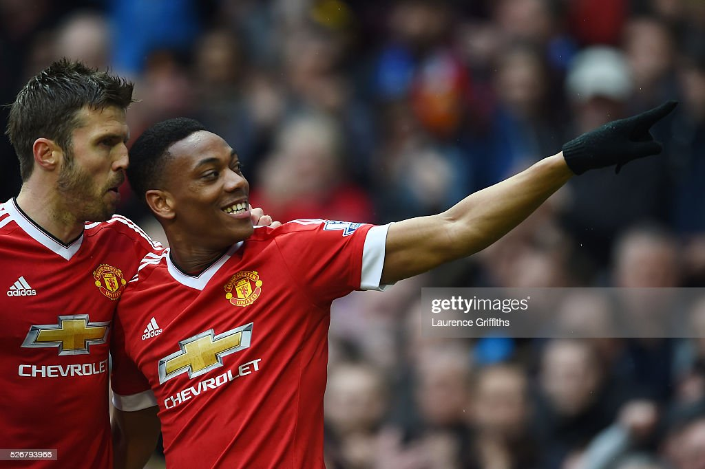 <a gi-track='captionPersonalityLinkClicked' href=/galleries/search?phrase=Anthony+Martial&family=editorial&specificpeople=9197434 ng-click='$event.stopPropagation()'>Anthony Martial</a> of Manchester United celebrates scoring the opening goal with <a gi-track='captionPersonalityLinkClicked' href=/galleries/search?phrase=Michael+Carrick&family=editorial&specificpeople=214599 ng-click='$event.stopPropagation()'>Michael Carrick</a> (L) during the Barclays Premier League match between Manchester United and Leicester City at Old Trafford on May 1, 2016 in Manchester, England.