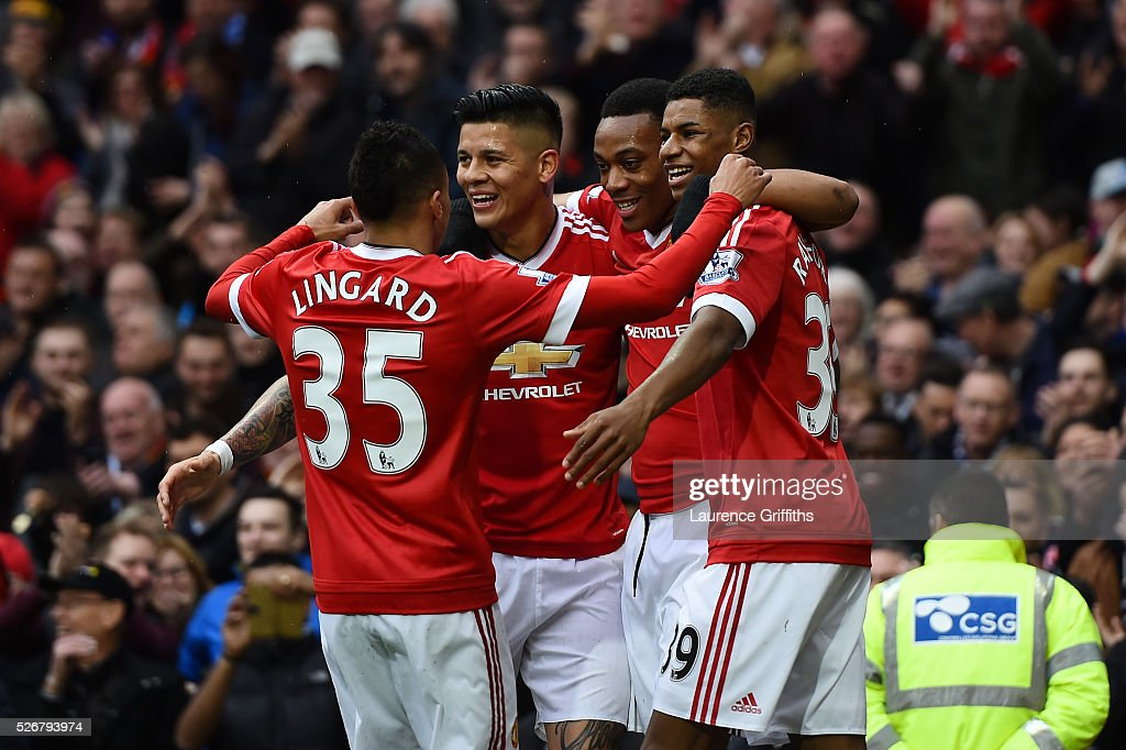 <a gi-track='captionPersonalityLinkClicked' href=/galleries/search?phrase=Anthony+Martial&family=editorial&specificpeople=9197434 ng-click='$event.stopPropagation()'>Anthony Martial</a> of Manchester United celebrates scoring the opening goal with team mates during the Barclays Premier League match between Manchester United and Leicester City at Old Trafford on May 1, 2016 in Manchester, England.