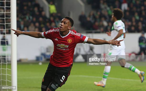 Anthony Martial of Manchester United celebrates scoring their first goal during the UEFA Champions League match between VfL Wolfsburg and Manchester...