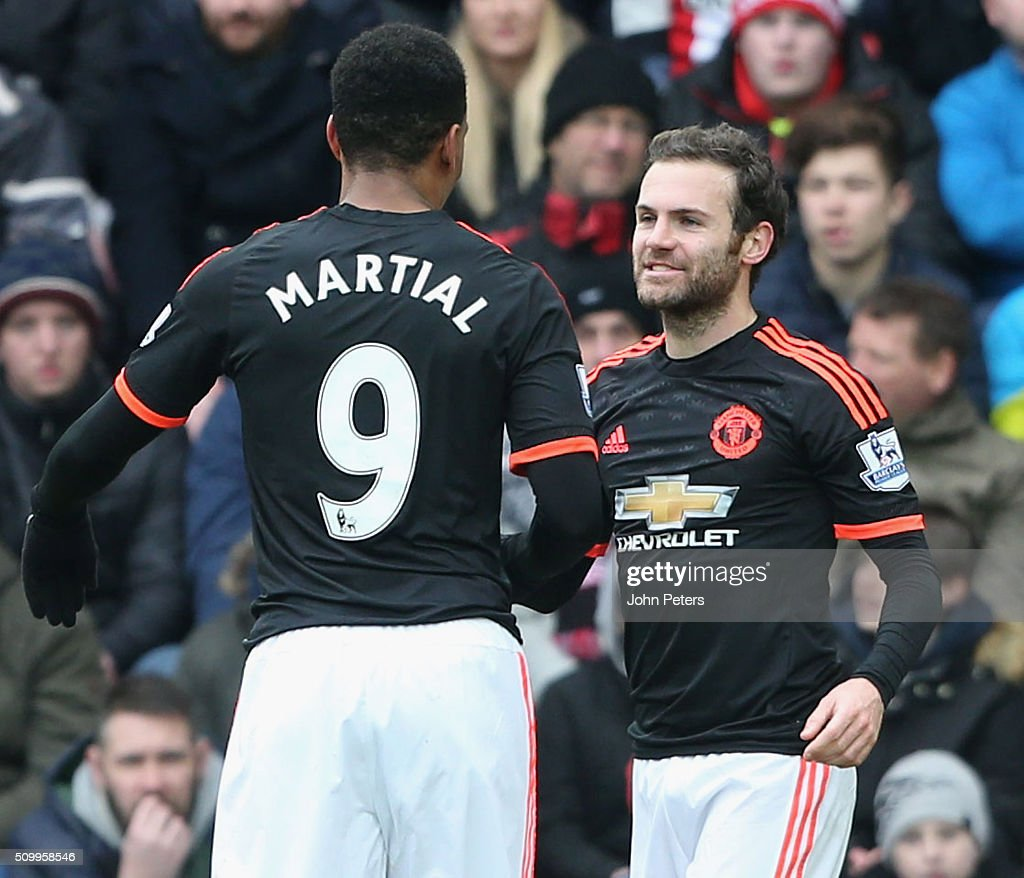 <a gi-track='captionPersonalityLinkClicked' href=/galleries/search?phrase=Anthony+Martial&family=editorial&specificpeople=9197434 ng-click='$event.stopPropagation()'>Anthony Martial</a> (C) of Manchester United celebrates scoring their first goal during the Barclays Premier League match between Sunderland and Manchester United at Stadium of Light on February 13, 2016 in Sunderland, England.