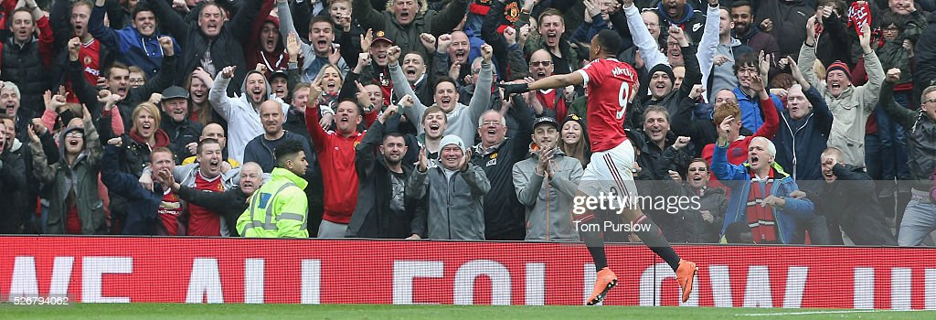 <a gi-track='captionPersonalityLinkClicked' href=/galleries/search?phrase=Anthony+Martial&family=editorial&specificpeople=9197434 ng-click='$event.stopPropagation()'>Anthony Martial</a> of Manchester United celebrates scoring their first goal during the Barclays Premier League match between Manchester United and Leicester City at Old Trafford on May 1, 2016 in Manchester, England.