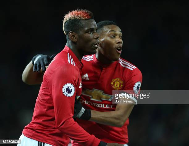 Anthony Martial of Manchester United celebrates scoring their first goal during the Premier League match between Manchester United and Newcastle...