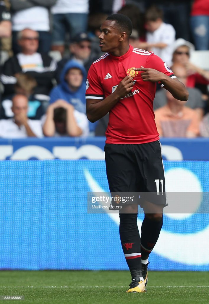 Anthony Martial of Manchester United celebrates scoring their fourth goal during the Premier League match between Swansea City and Manchester United at Liberty Stadium on August 19, 2017 in Swansea, Wales.