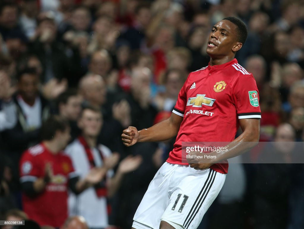 Anthony Martial of Manchester United celebrates scoring their fourth goal during the Carabao Cup Third Round between Manchester United and Burton Albion at Old Trafford on September 20, 2017 in Manchester, England.