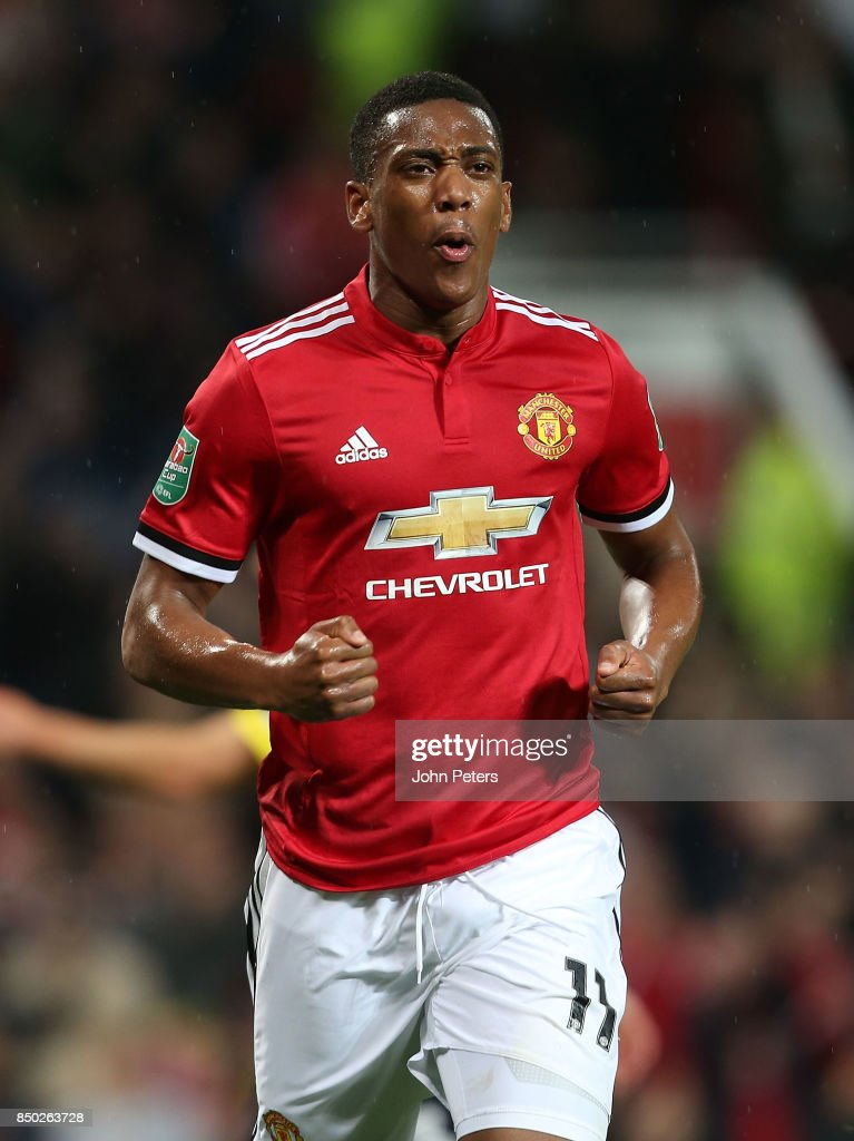 Anthony Martial of Manchester United celebrates scoring their fourth goal during the Carabao Cup Third Round match between Manchester United and Burton Albion at Old Trafford on September 20, 2017 in Manchester, England.