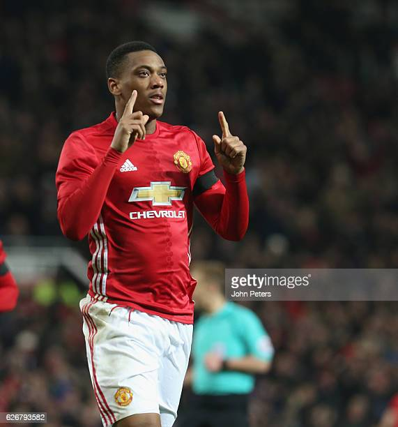 Anthony Martial of Manchester United celebrates scoring their second goal during the EFL Cup QuarterFinal match between Manchester United and West...