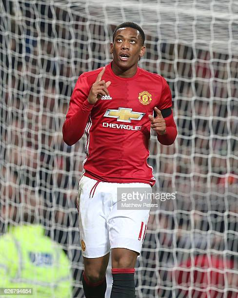 Anthony Martial of Manchester United celebrates scoring their third goal during the EFL Cup QuarterFinal match between Manchester United and West Ham...