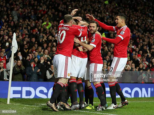 Anthony Martial of Manchester United celebrates with his teammates after scoring a goal to make it 10 during the Barclays Premier League match...