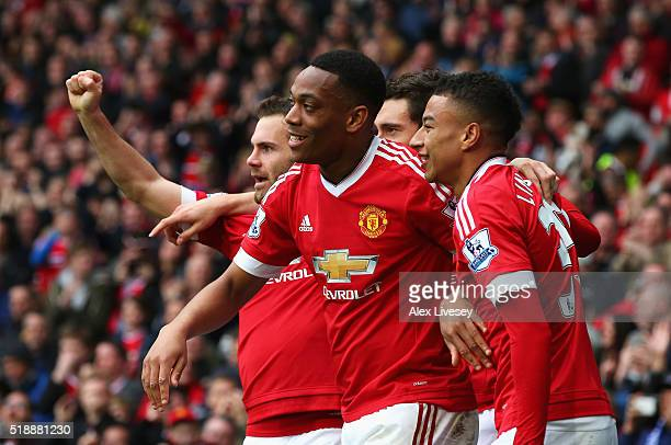 Anthony Martial of Manchester United celebrates with Juan Mata and Jesse Lingard as he scores their first goal during the Barclays Premier League...