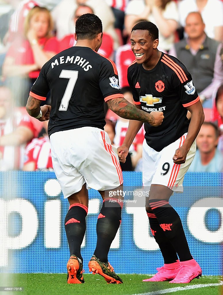 Anthony Martial of Manchester United celebrates with Memphis Depay as he scores his and his team's second goal during the Barclays Premier League...