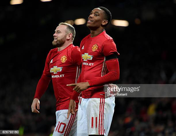 Anthony Martial of Manchester United celebrates with team mate Wayne Rooney after scoring his team's second goal of the game during the EFL Cup...