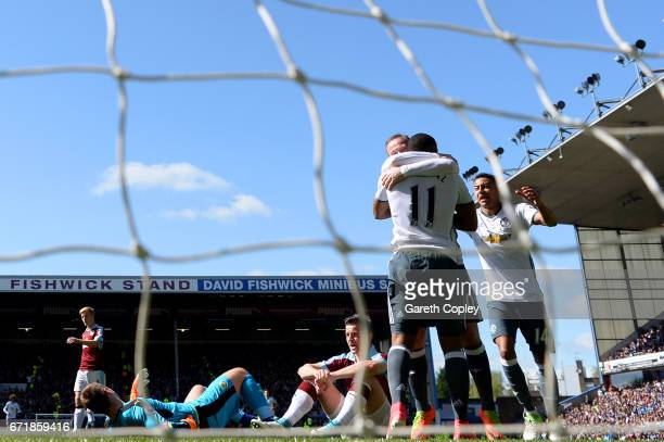 Anthony Martial of Manchester United celebrates with Wayne Rooney after scoring the opening goal as Thomas Heaton and Joey Barton of Burnley show...