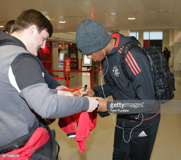Anthony Martial of Manchester United checks in ahead of their flight to Basel at Manchester Airport on November 21 2017 in Manchester England