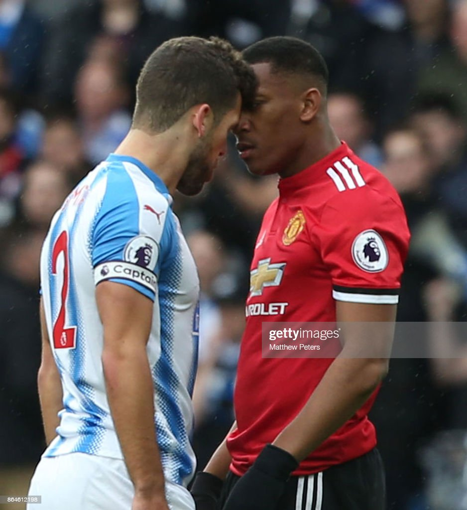 Anthony Martial of Manchester United clashes with Tommy Smith of Huddersfield Town during the Premier League match between Huddersfield Town and Manchester United at John Smith's Stadium on October 21, 2017 in Huddersfield, England.