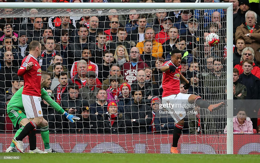 <a gi-track='captionPersonalityLinkClicked' href=/galleries/search?phrase=Anthony+Martial&family=editorial&specificpeople=9197434 ng-click='$event.stopPropagation()'>Anthony Martial</a> of Manchester United clears the ball off the goal line during the Barclays Premier League match between Manchester United and Leicester City at Old Trafford on May 1, 2016 in Manchester, United Kingdom.
