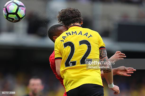 Anthony Martial of Manchester United collides with Daryl Janmaat of Watford while battle for possession in the air during the Premier League match...