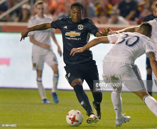 Anthony Martial of Manchester United directs the ball past Marcelo Silva of Real Salt Lake during the International friendly game at Rio Tinto...