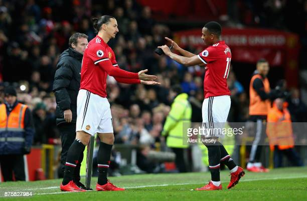 Anthony Martial of Manchester United gives a high five to Zlatan Ibrahimovic of Manchester United before he is being substituted during the Premier...