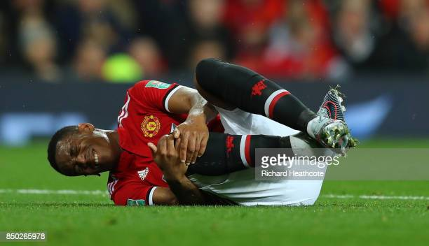 Anthony Martial of Manchester United goes down injured during the Carabao Cup Third Round match between Manchester United and Burton Albion at Old...