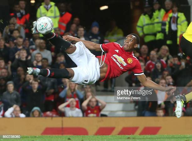 Anthony Martial of Manchester United has a shot on goal during the Carabao Cup Third Round between Manchester United and Burton Albion at Old...