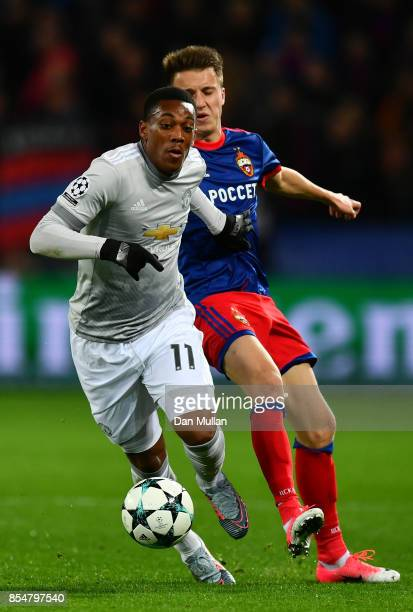 Anthony Martial of Manchester United holds off Aleksandr Golovin of CSKA Moscow during the UEFA Champions League group A match between CSKA Moskva...