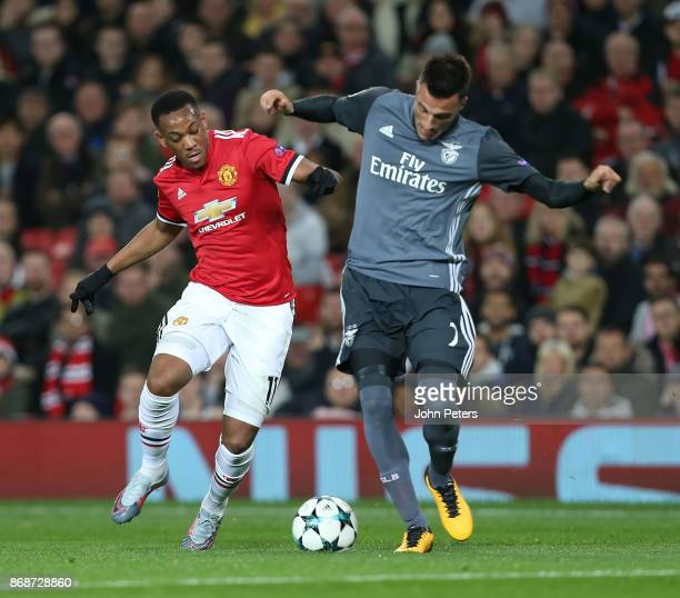 Anthony Martial of Manchester United in action with Andreas Samaris of Benfica during the UEFA Champions League group A match between Manchester...