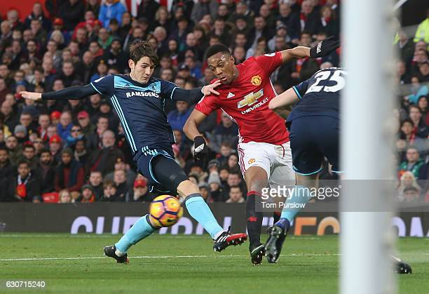 Anthony Martial of Manchester United in action with Calum Chambers and Marten de Roon of Middlesbrough during the Premier League match between...
