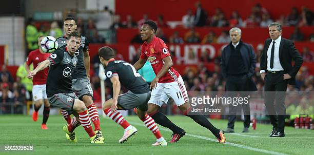 Anthony Martial of Manchester United in action with Cedric Soares of Southampton during the Premier League match between Manchester United and...