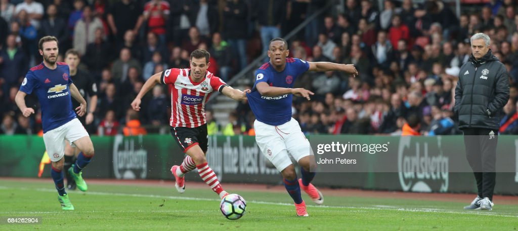 Anthony Martial of Manchester United in action with Cedric Soares of Southampton during the Premier League match between Southampton and Manchester United at St Mary's Stadium on May 17, 2017 in Southampton, England.
