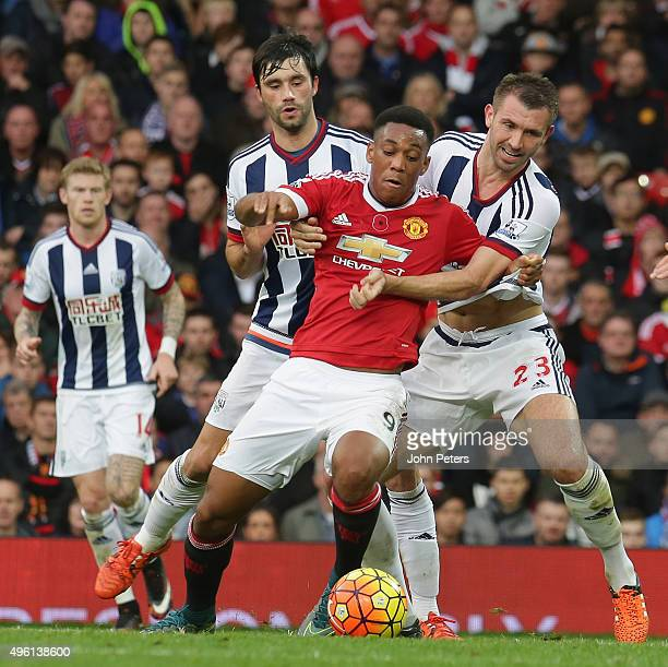 Anthony Martial of Manchester United in action with Claudio Yacob and Gareth McAuley of West Bromwich Albion during the Barclays Premier League match...