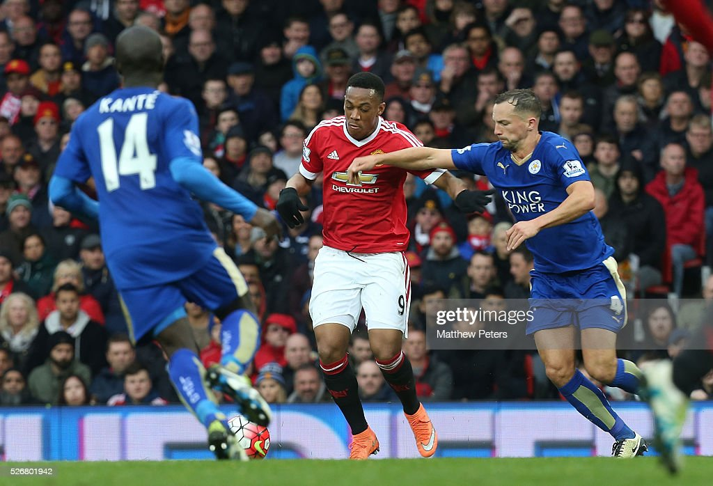 <a gi-track='captionPersonalityLinkClicked' href=/galleries/search?phrase=Anthony+Martial&family=editorial&specificpeople=9197434 ng-click='$event.stopPropagation()'>Anthony Martial</a> of Manchester United in action with <a gi-track='captionPersonalityLinkClicked' href=/galleries/search?phrase=Danny+Drinkwater&family=editorial&specificpeople=4224396 ng-click='$event.stopPropagation()'>Danny Drinkwater</a> of Leicester City during the Barclays Premier League match between Manchester United and Leicester City at Old Trafford on May 1, 2016 in Manchester, England.