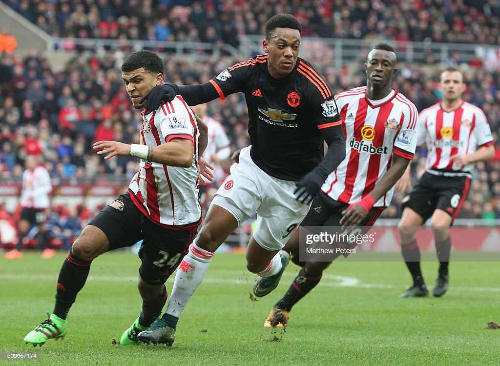 Anthony Martial of Manchester United in action with DeAndre Yedlin of Sunderland during the Barclays Premier League match between Sunderland and Manchester United at Stadium of Light on February 13, 2016 in Sunderland, England.