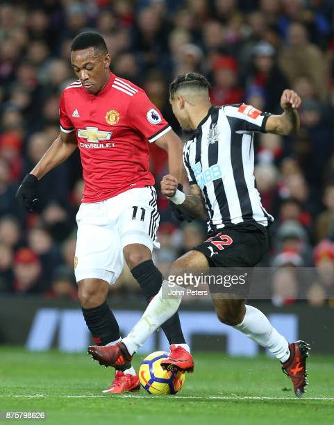Anthony Martial of Manchester United in action with Deandre Yedlin of Newcastle United during the Premier League match between Manchester United and...