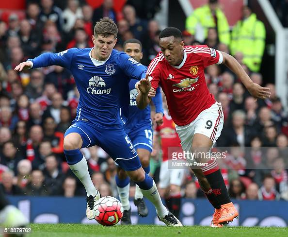 Anthony Martial of Manchester United in action with during John Stones of Everton during the Barclays Premier League match between Manchester United...