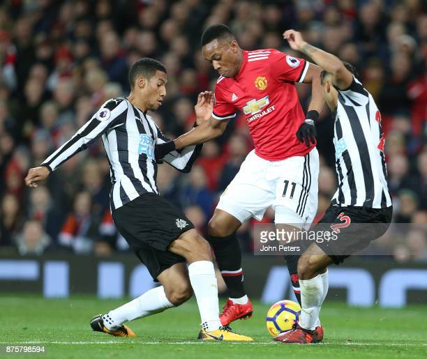 Anthony Martial of Manchester United in action with Isaac Hayden and Deandre Yedlin of Newcastle United during the Premier League match between...