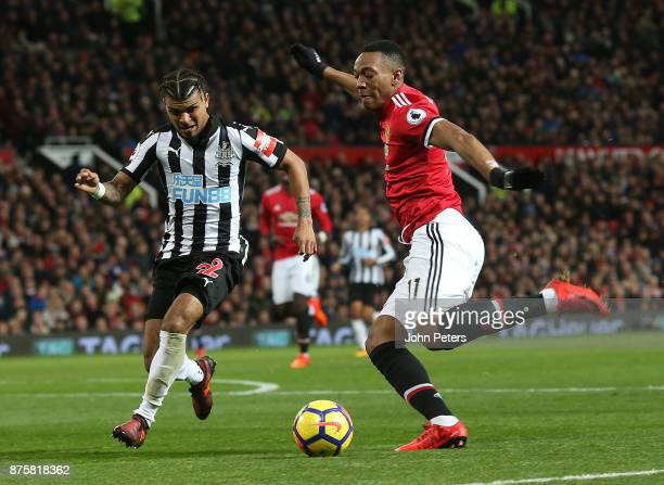 Anthony Martial of Manchester United in action with Javier Manquillo of Newcastle United during the Premier League match between Manchester United...