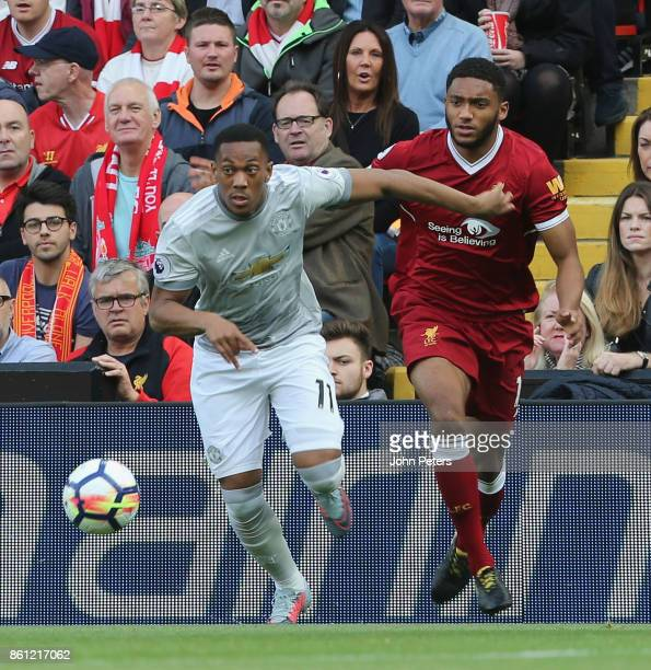 Anthony Martial of Manchester United in action with Joe Gomez of Liverpool during the Premier League match between Liverpool and Manchester United at...