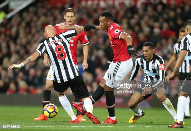 Anthony Martial of Manchester United in action with Jonjo Shelvey of Newcastle United during the Premier League match between Manchester United and...