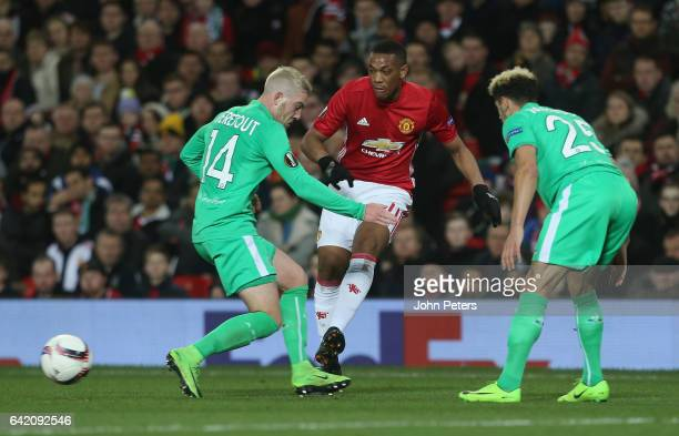Anthony Martial of Manchester United in action with Jordan Veretout and Kevin Malcuit of AS SaintEtienne during the UEFA Europa League Round of 32...