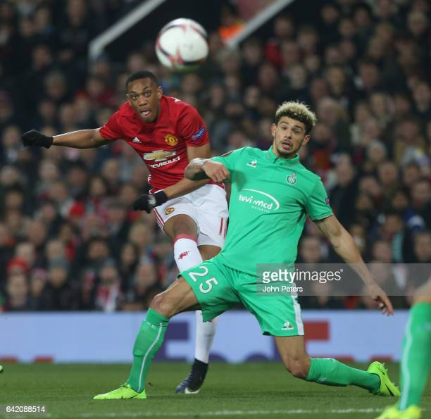 Anthony Martial of Manchester United in action with Kevin Malcuit of AS SaintEtienne during the UEFA Europa League Round of 32 first leg match...