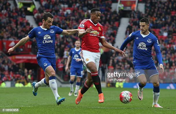 Anthony Martial of Manchester United in action with Leighton Baines and Kevin Mirallas of Everton during the Barclays Premier League match between...