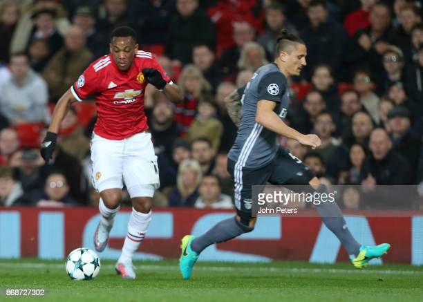Anthony Martial of Manchester United in action with Ljubomir Fejsa of Benfica during the UEFA Champions League group A match between Manchester...