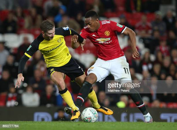 Anthony Martial of Manchester United in action with Luke Murphy of Burton Albion during the Carabao Cup Third Round between Manchester United and...