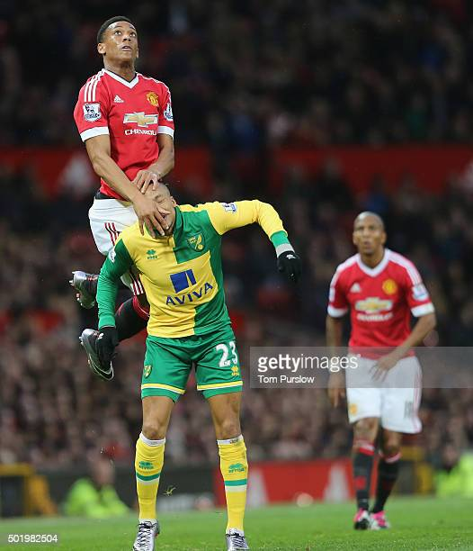 Anthony Martial of Manchester United in action with Martin Olsson of Norwich City during the Barclays Premier League match between Manchester United...