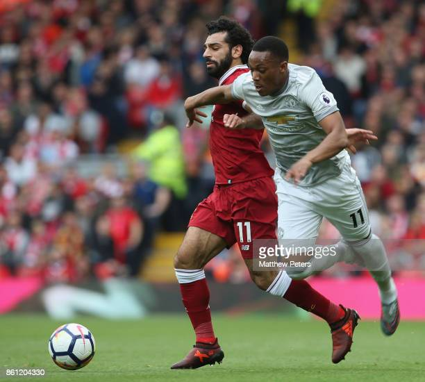 Anthony Martial of Manchester United in action with Mohamed Salah of Liverpool during the Premier League match between Liverpool and Manchester...
