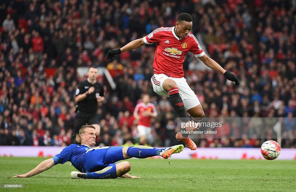 Anthony Martial of Manchester United in action with Robert Huth of Leicester City during the Barclays Premier League match between Manchester United and Leicester City at Old Trafford on May 1, 2016 in Manchester, England.