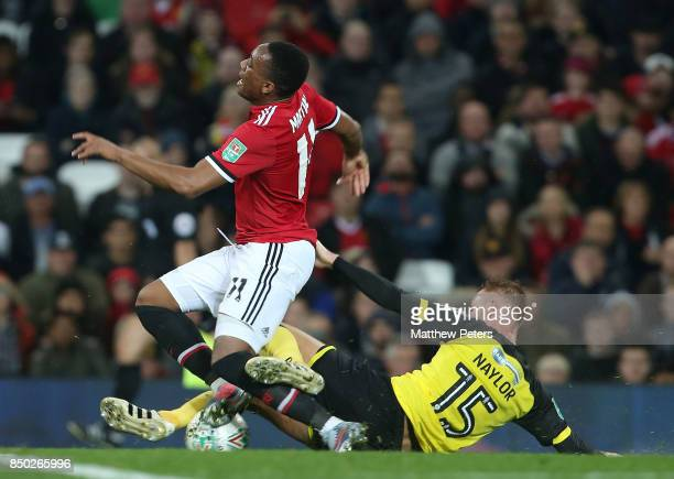 Anthony Martial of Manchester United in action with Tom Naylor of Burton Albion during the Carabao Cup Third Round between Manchester United and...
