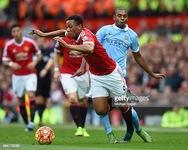 Anthony Martial of Manchester United is challenged by Fernandinho of Manchester City during the Barclays Premier League match between Manchester...
