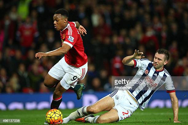 Anthony Martial of Manchester United is fouled by Gareth McAuley of West Bromwich Albion in the penalty area resulting in the Manchester United's...